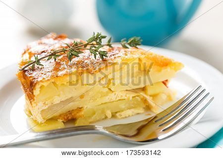 Potato breakfast gratin with parmesan on plate