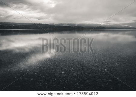 Image of a calm lake on an overcast day.