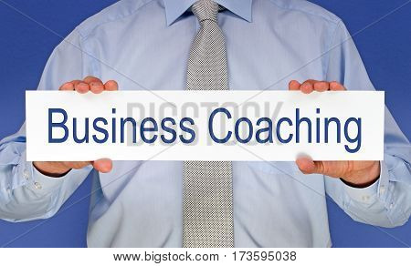 Business Coaching - Manager holding sign with text