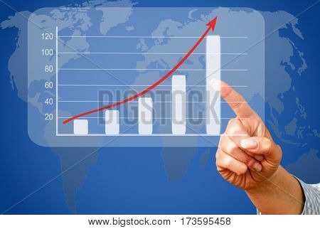 Business success and sales uptake chart with female hand and world map in the background