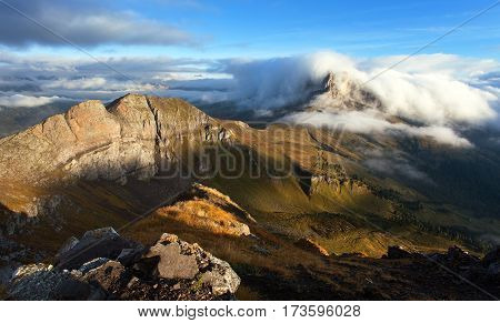 Morning view from Col di Lana to Pico Setsas in the middle clouds and fog South Tirol Dolomites mountains Italy
