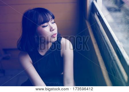 Asian ethnicity girl is on a train.
