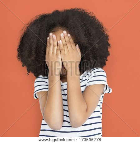 African Descent Little Girl Face Covered Concept