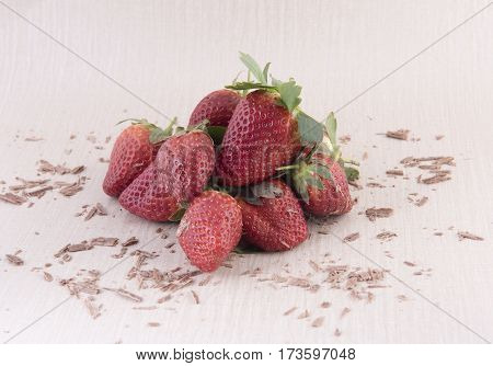 Pile of fresh strawberries covered with chocolate sprinkles