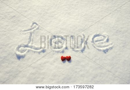 Word Love And Red Heart On Snow