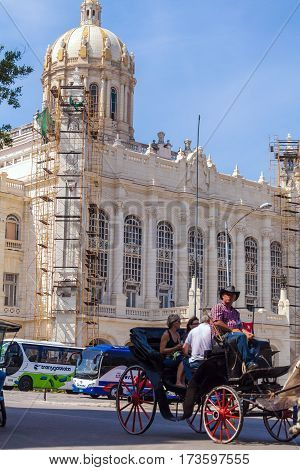 Havana, Cuba - April 1, 2012: Tourists Riding Horse Carriage Near Revolution Museum