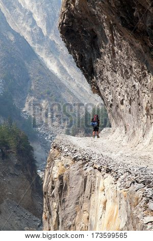 man on the way rock and road in round Annapurna circuit trekking trail Nepal