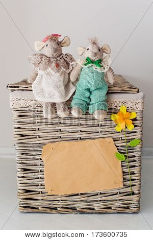 Blank sheet and a teddy bear on a basket with flower
