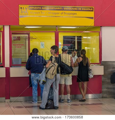 Havana, Cuba - April 2, 2012: Tourists In Hose Marti Airport Buying Special Sticker Tax