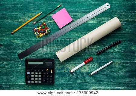 Tools and papers with sketches roll on the table .Top view