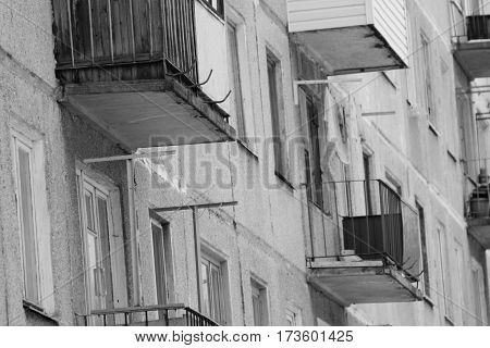 Vintage city ussr style buildings with balcony, windows background in black and white style