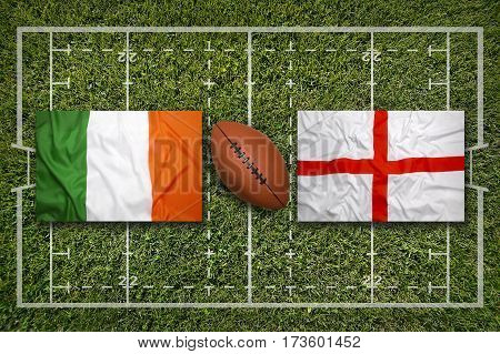 Ireland vs. England flags on green rugby field, 3 D illustration