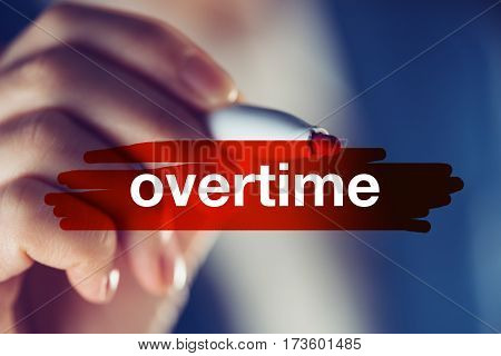 Overtime business concept businesswoman highlighting word with red marker pen