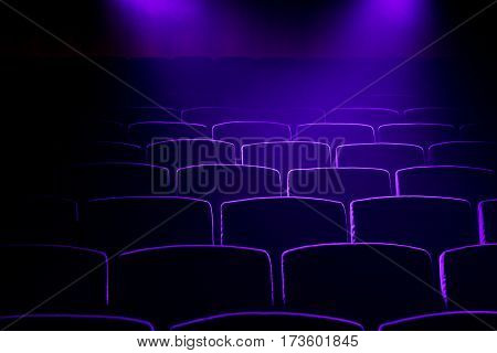 Cinema  theater seats with projection light falling into the lens
