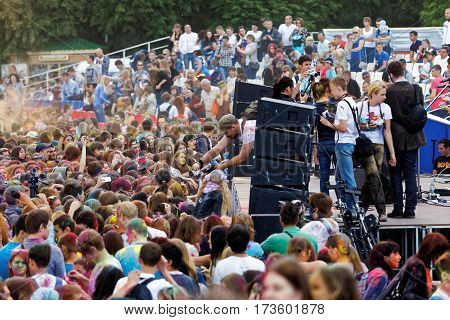 Ulyanovsk Russia - JUNE 12 2015: Crowd of people celebrating the festival of Holi near the stage. Holi is traditional holiday of India.