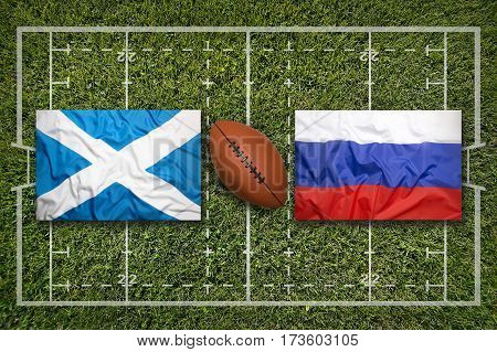 Scotland vs. Russia flags on green rugby field, 3 D illustration