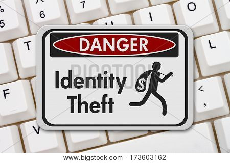 ID theft danger sign A black and white danger sign with text Identity theft and theft icon on a keyboard 3D Illustration