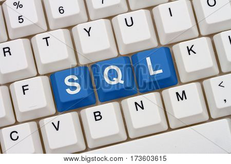 Computer coding with SQL A close-up of a keyboard with blue highlighted text SQL 3D Illustration