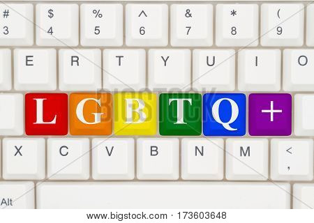 A close-up of a keyboard with highlighted in pride colors text LGBTQ+ 3D Illustration