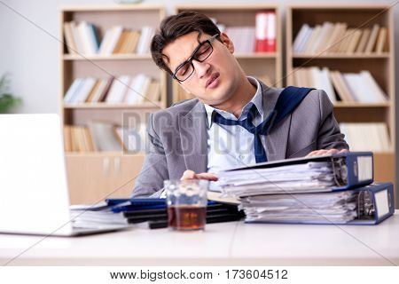 Young businessman drinking from stress