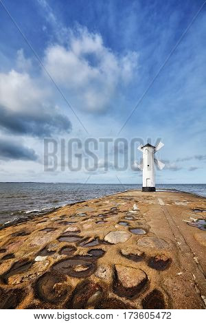 An Old White Lighthouse In Swinoujscie, Poland