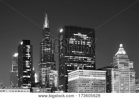 Black and white picture of Chicago downtown at night Illinois USA.
