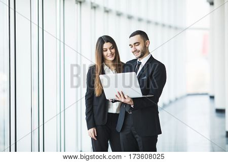 Couple discussing new project on the laptop. Teamwork concepts.