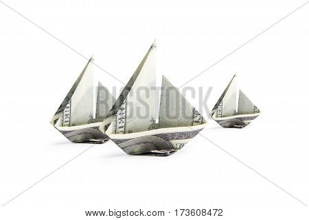 origami ship from banknotes on a white background