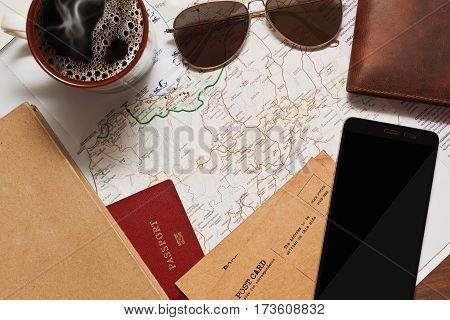 Planning some outdoor activities on vacations with a map tablet or cell phone and of course with a cup of coffee