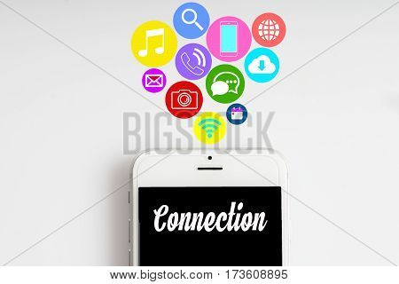 """Connection"" words on smartphone with social media icon with white background - business finance and copy space concept"