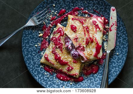 Pancakes With Custard And Cherry Strawberry Coulis And Nuts