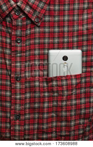 Male checkered cowboy's shirt with a cell phone in the pocket