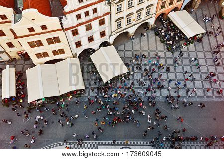 Prague cityscape with medieval buildings and crowd on the Old Square