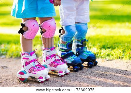 Kids Roller Skating In Summer Park