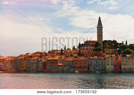 Classic mediterranean with cathedral colorful houses and warm sea