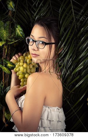 attractive girl with grapes close up in studio