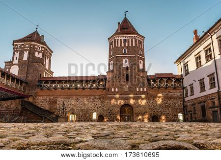 Mir Belarus - August 28 2016: The courtyard of a medieval castle in the town of Mir Belarus paved with setts. Mir Castle Complex. Low angle view