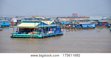 TONLE SAP CAMBODIA LAKE MARCH 31: Floating house along the Tonle sap River is a combined lake and river system of major importance to Cambodia on march 31 2013 in Tonle Sap Lake Cambodia.