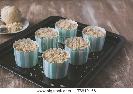 Making Muffins, Adding Streusel To The Pastry