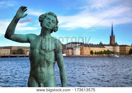 STOCKHOLM SWEDEN - AUGUST 20 2016: Song statues near Stockholm City Hall ( Stadshuset ) and View of Gamla Stan from Stockholm City Hall in Stockholm Sweden on August 20 2016.