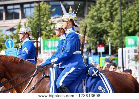 STOCKHOLM SWEDEN - AUGUST 20 2016: Swedish Royal Guards on horse in blue uniforms in the dayly procession on Stromgatan street in Stockholm Sweden on August 20 2016.