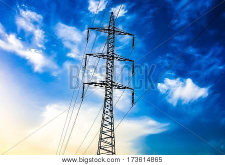 Electric Post and Wires in the Background of Blue Sky High-voltage post on a background