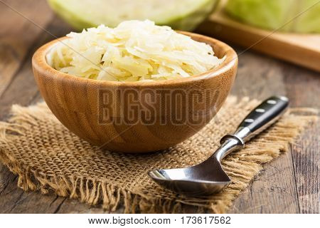 homemade greek coleslaw served in a small wooden bow.
