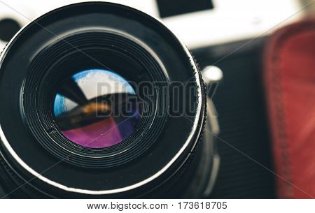 Camera lens. Retro stale. equipment on a wooden background