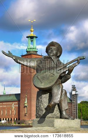 STOCKHOLM SWEDEN - AUGUST 19 2016: View of Evert Taube monument with guitar on Gamla stan in Stockholm Sweden in Stockholm Sweden on August 19 2016.