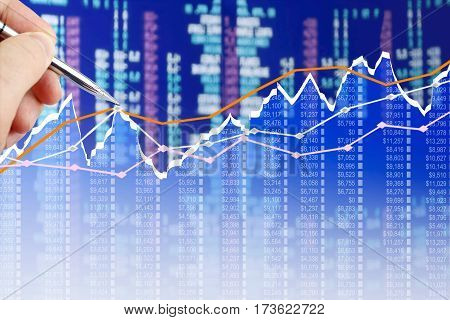 Businessman analyzing financial chart on virtual screen