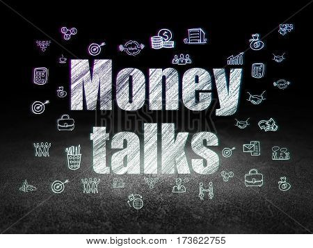 Finance concept: Glowing text Money Talks,  Hand Drawn Business Icons in grunge dark room with Dirty Floor, black background