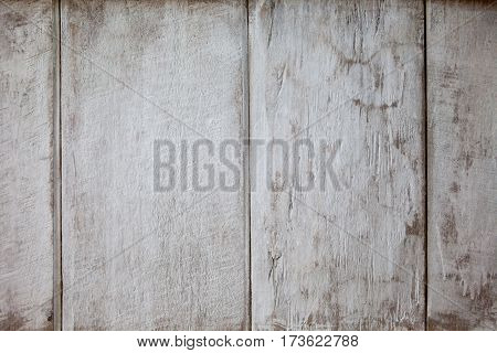 Background texture of old white painted wooden lining boards wall. Fence surface