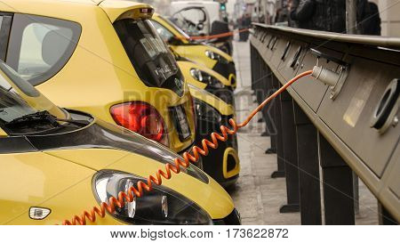 Power supply for electric car charging. City electric car charging station. Close-up.