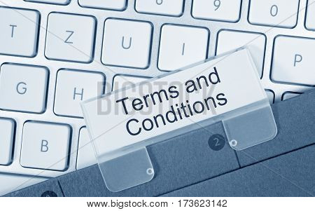 Terms and Conditions - folder on computer keyboard